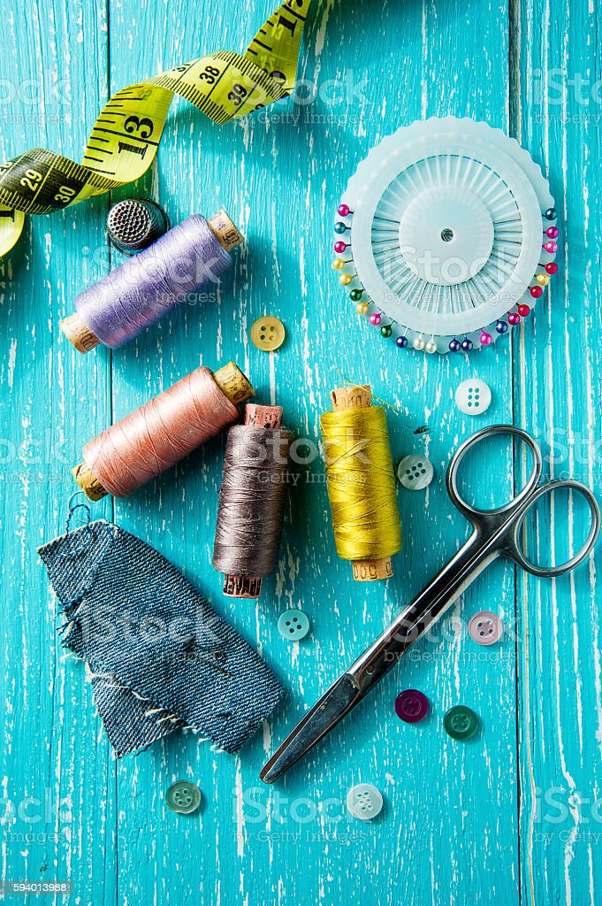 Set for sewing and needlework on a wooden board in stock photo
