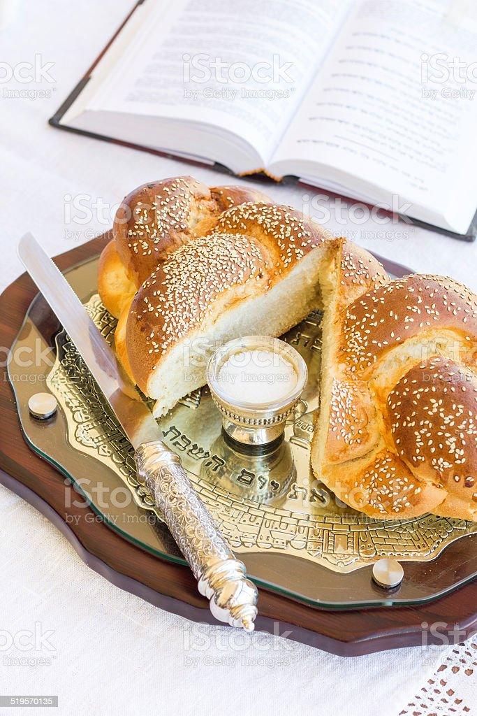 Set for Shabbat with challah bread on a wooden table stock photo