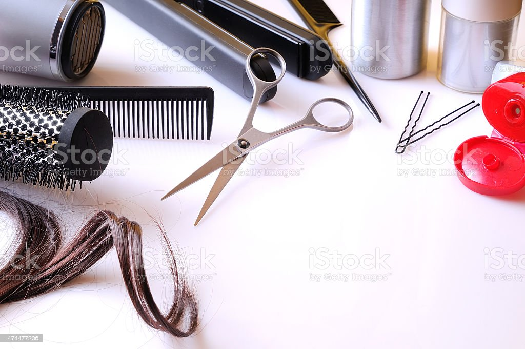 Set hairdressing articles on a white table Set hairdressing articles exposed on a white table with room below right to write 2015 Stock Photo