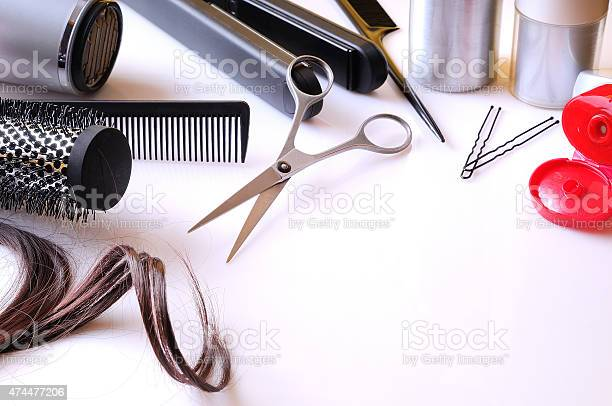 Set Hairdressing Articles On A White Table Stock Photo - Download Image Now