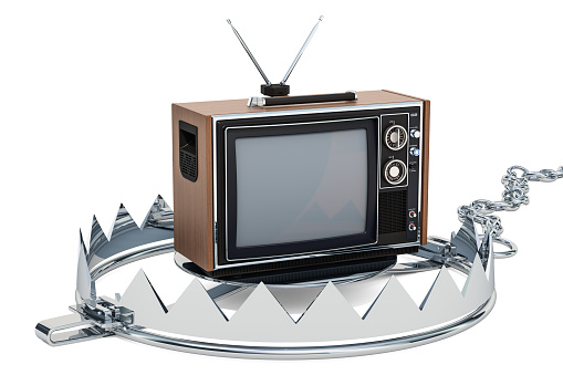 istock TV set inside bear trap. TV dependence concept, 3D rendering isolated on white background 1058889954