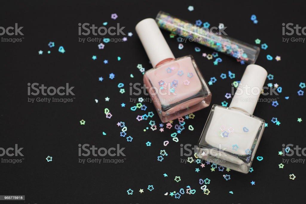 Set Nail Polishes Bottles Siny Sparkle Decoration Isoalted on Black stock photo