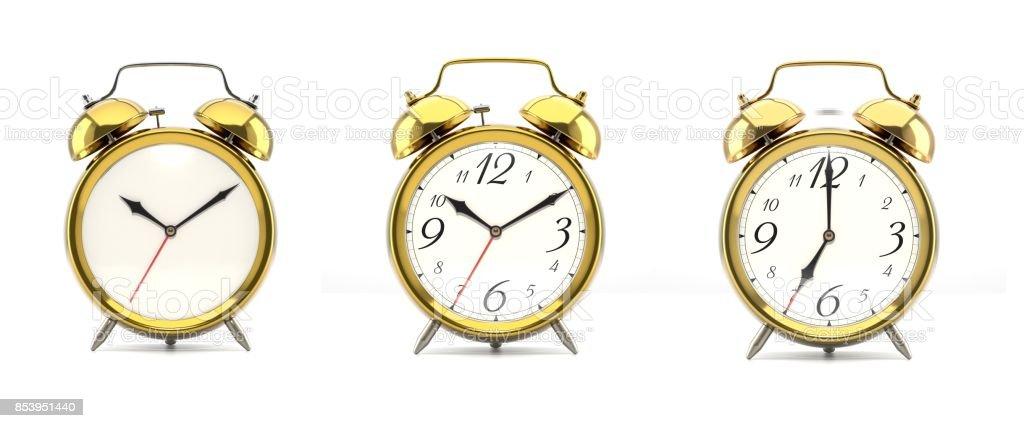 Set of 4 golden alarm clocks stock photo