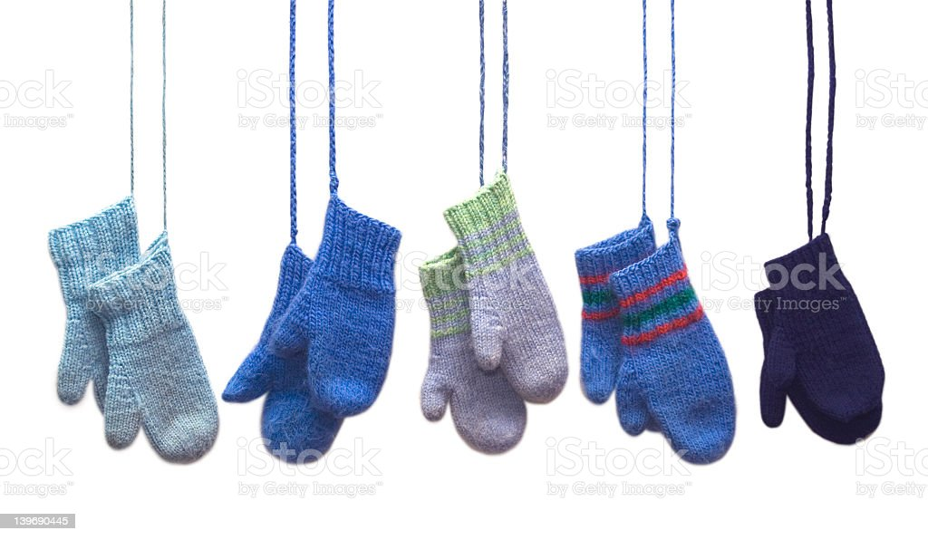 Set of 5 pairs of knitted mittens hanging down stock photo