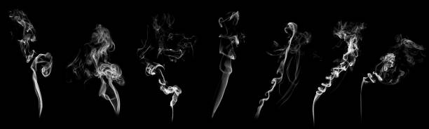 set of abstract isolated moving smoke with black background. - sigaretta foto e immagini stock