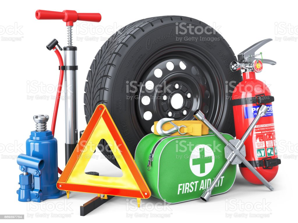 A set of automotive accessories. Spare wheel, fire extinguisher, first aid kit, emergency warning triangle, jack, tow rope, wheel wrench, pump. stock photo