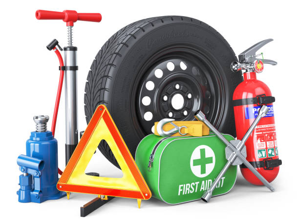 a set of automotive accessories. spare wheel, fire extinguisher, first aid kit, emergency warning triangle, jack, tow rope, wheel wrench, pump. - acessório imagens e fotografias de stock