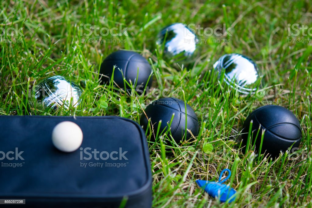 Set of balls for playing bocce on the lawn stock photo