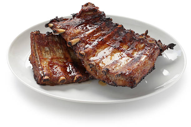 a set of barbecue pork spare ribs - ribs stock photos and pictures