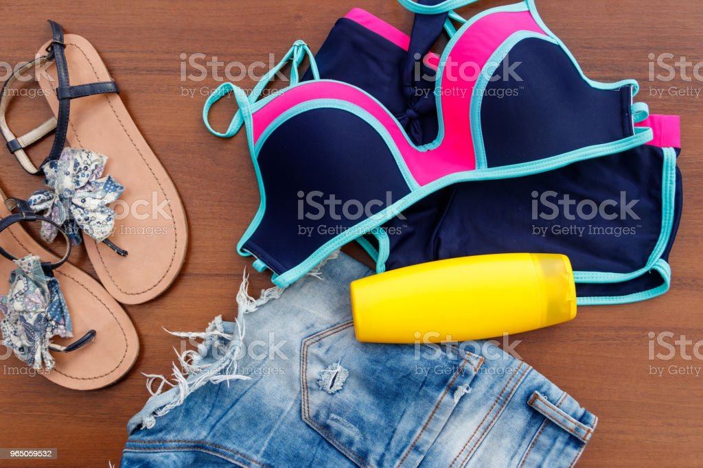 Set of beachwear on wooden background royalty-free stock photo