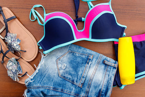 Set Of Beachwear On Wooden Background Stock Photo - Download Image Now