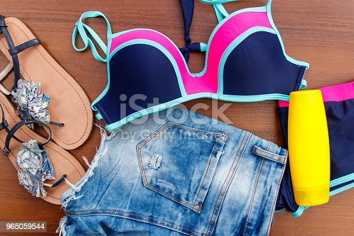 Set Of Beachwear On Wooden Background Stock Photo & More Pictures of Beach