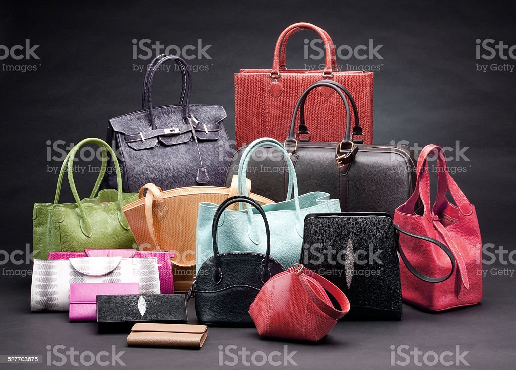 Set of beautiful leather handbags stock photo