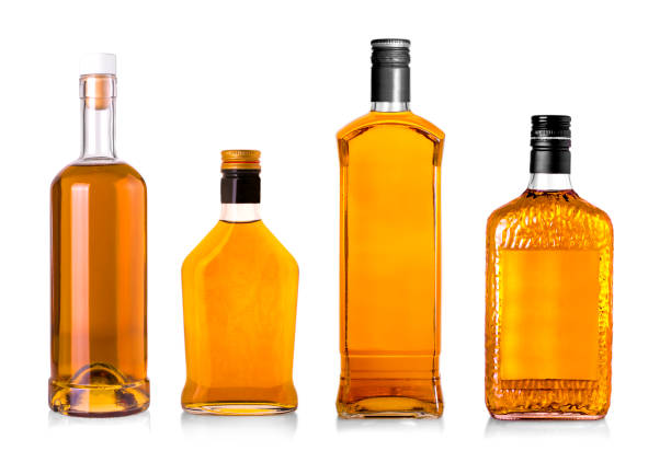 Set of Beautiful Whisky Bottles against well lit background. stock photo