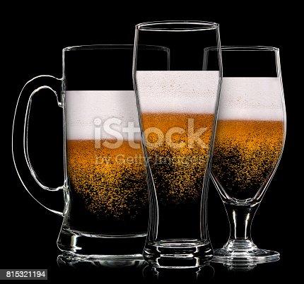 istock Set of beer glasses on black background 815321194