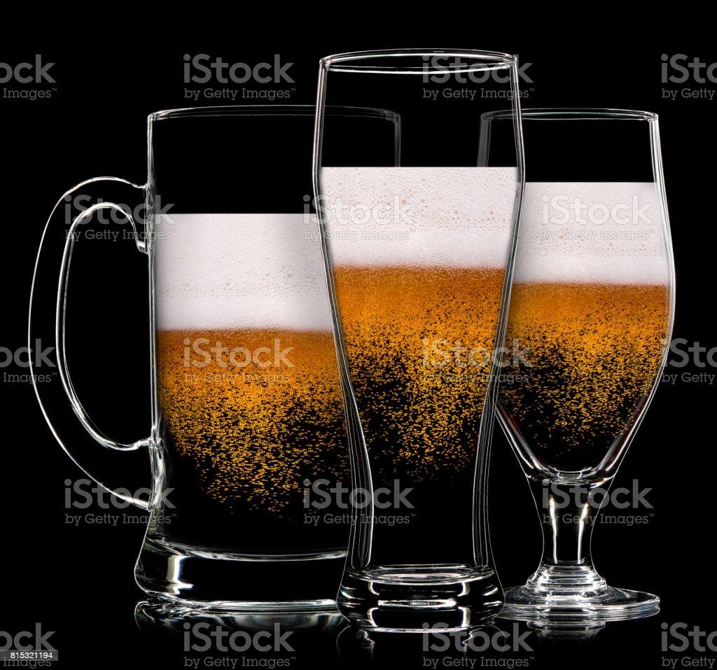 Set of beer glasses on black background stock photo