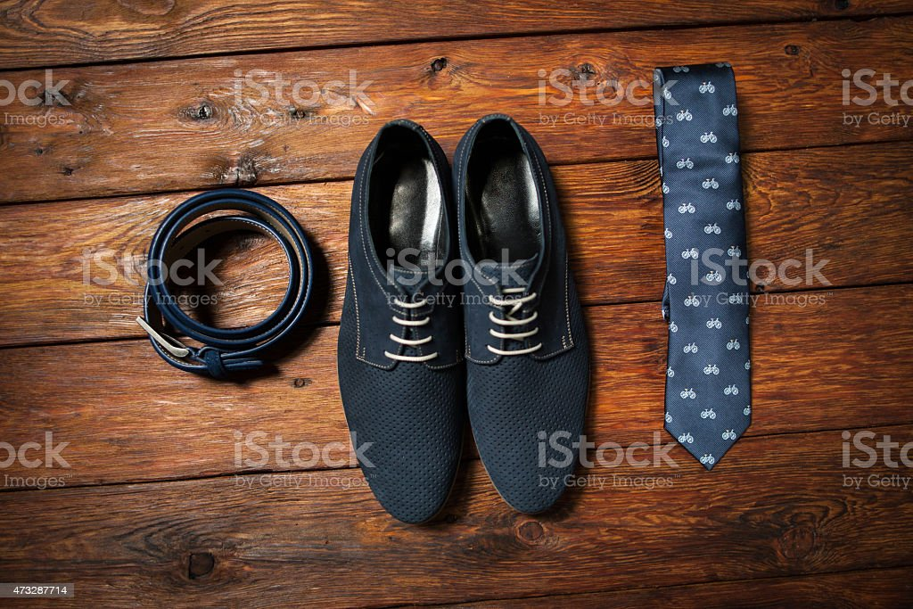 Set of belt, shoes and tie for men on the wooden floor  stock photo