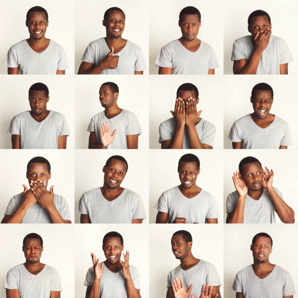 Set of black man's portraits with different emotions stock photo