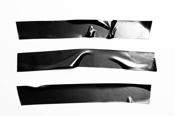 Set of black tapes on white background. Torn horizontal and different size black sticky tape, adhesive pieces. stock photo
