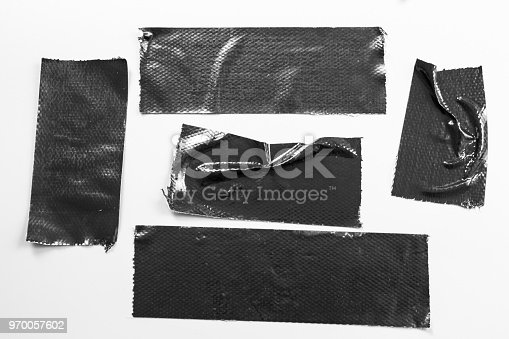 istock Set of black tapes on white background. Torn horizontal and different size black sticky tape, adhesive pieces. 970057602