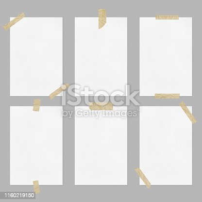 istock Set of blank white paper sheets with adhesive tapes on light gray background 1160219150