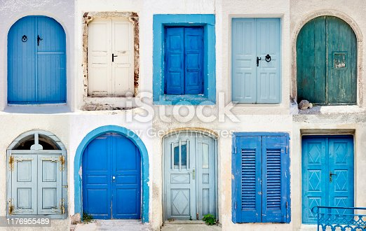 Set of blue and white doors on whitewashed buildings in Santorini, island of Greece in Europe. Tourism and traveling background. Santorini postcard concept.