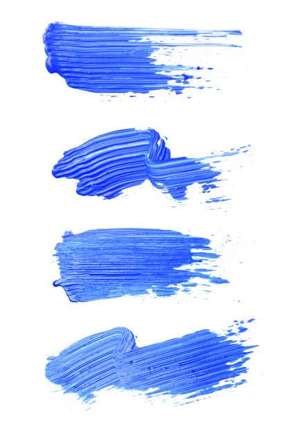 Set of blue brush strokes of acrilic paint as sample of art product stock photo