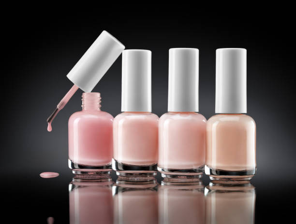 Set of bottles pearl colors nail polish on dark background Set of bottles pearl colors nail polish on dark background. Close up. Beauty concept glossa stock pictures, royalty-free photos & images