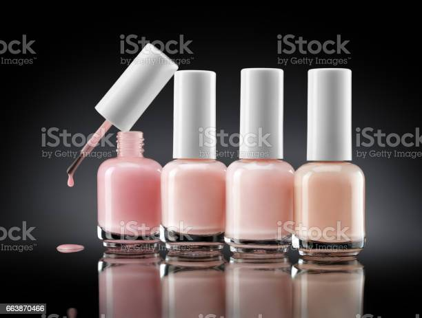 Set Of Bottles Pearl Colors Nail Polish On Dark Background Stock Photo - Download Image Now