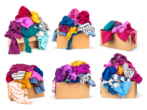 Set of boxes with clothes Set of boxes with clothes on white background. clothes in box stock pictures, royalty-free photos & images