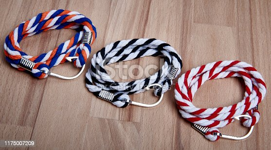 set of bracelets made of colored threads with a metal hook clasp