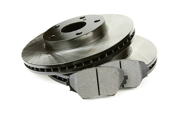 Set of brake discs and pads Front brake discs and two brake pads. propeller stock pictures, royalty-free photos & images