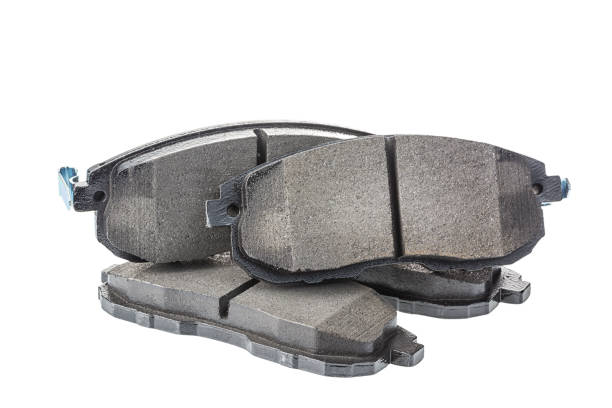 Set of brake pads, car spares isolated on white stock photo