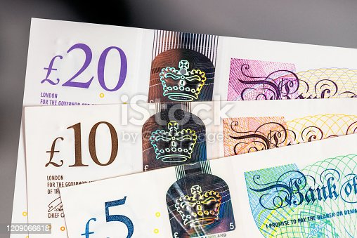 Close-up showing a set of UK polymer banknotes, issued by the Bank of England, with a £5, £10 and £20.