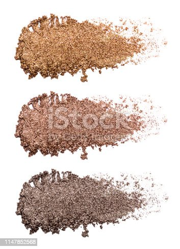Set of bronze eye shadow strokes isolated on white background. Closeup of a makeup product.
