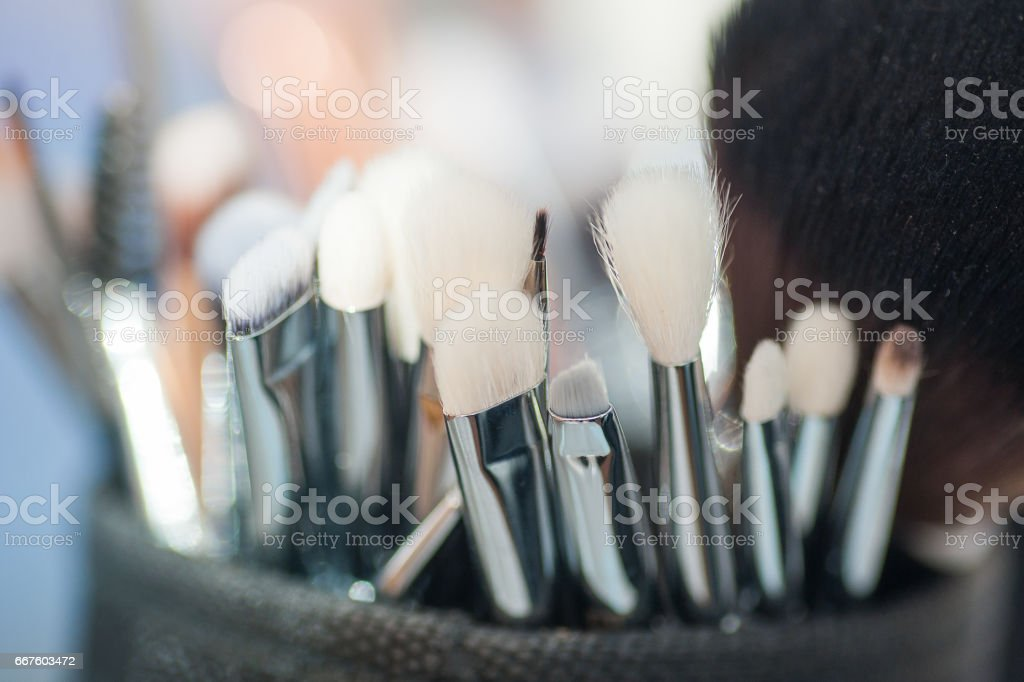 set of brushes for makeup in a box stock photo