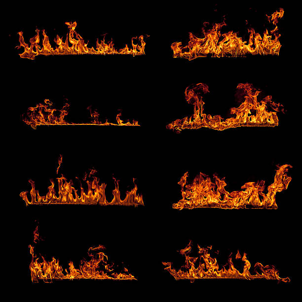 Set of burning fire flame elements isolated on black stock photo