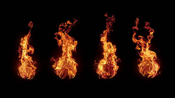 Set of burning fire flames isolated on black stock photo