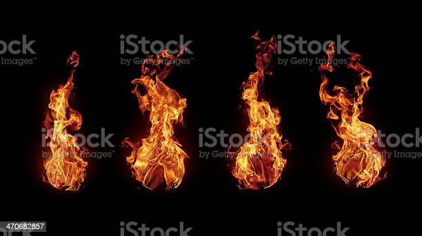 Photo of Set of burning fire flames isolated on black
