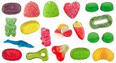 異なった形、色および味のお菓子のセット