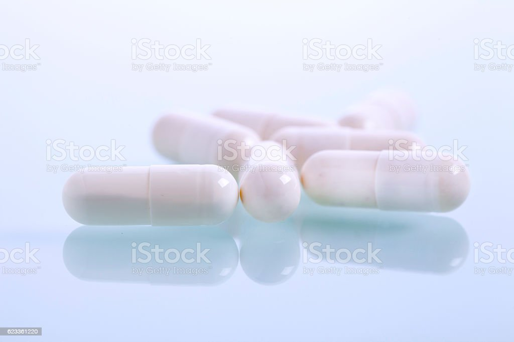 Set of capsules on white background stock photo