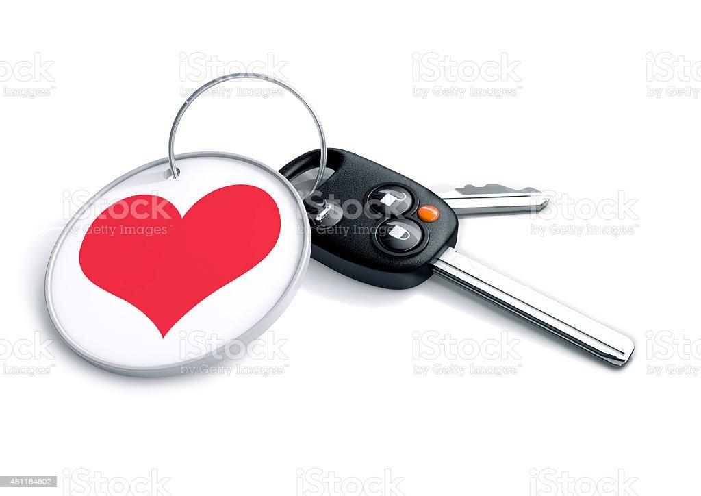 Jeu de clés avec un porte-clés et rouge icône en forme de cœur. - Photo