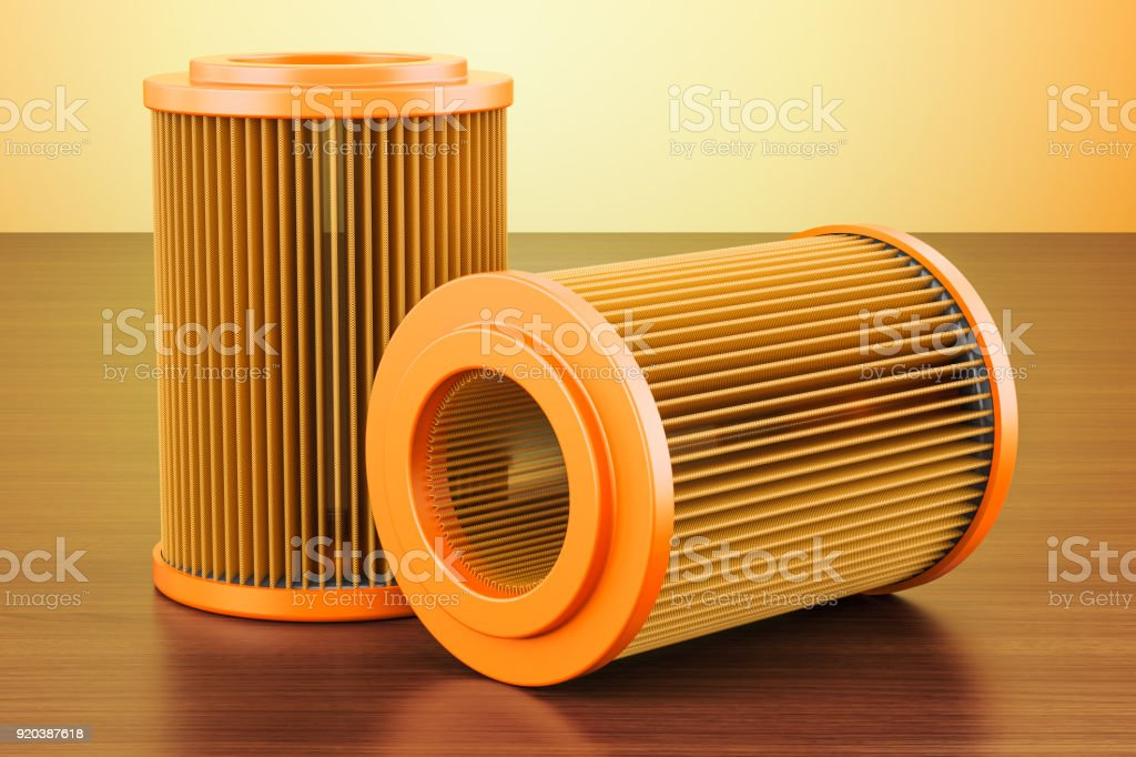 Set of car oil filters on the wooden table. 3D rendering stock photo