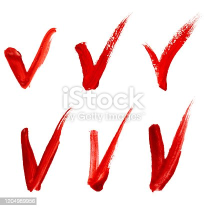 istock Set of check marks made with a red paint 1204989956