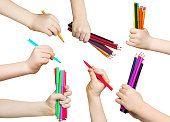 Set of child hands holding pencils and felt pens on white background. Set of male hands.