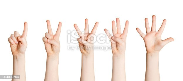 693519466 istock photo Set of child hands showing figures, counting 964090764
