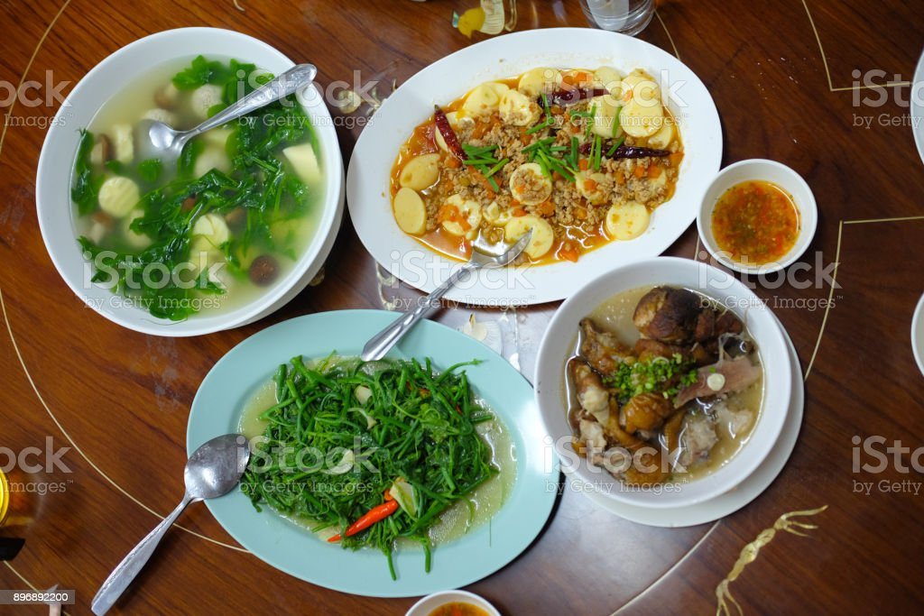 Set of Chinese food Yunnan style on wood table stock photo