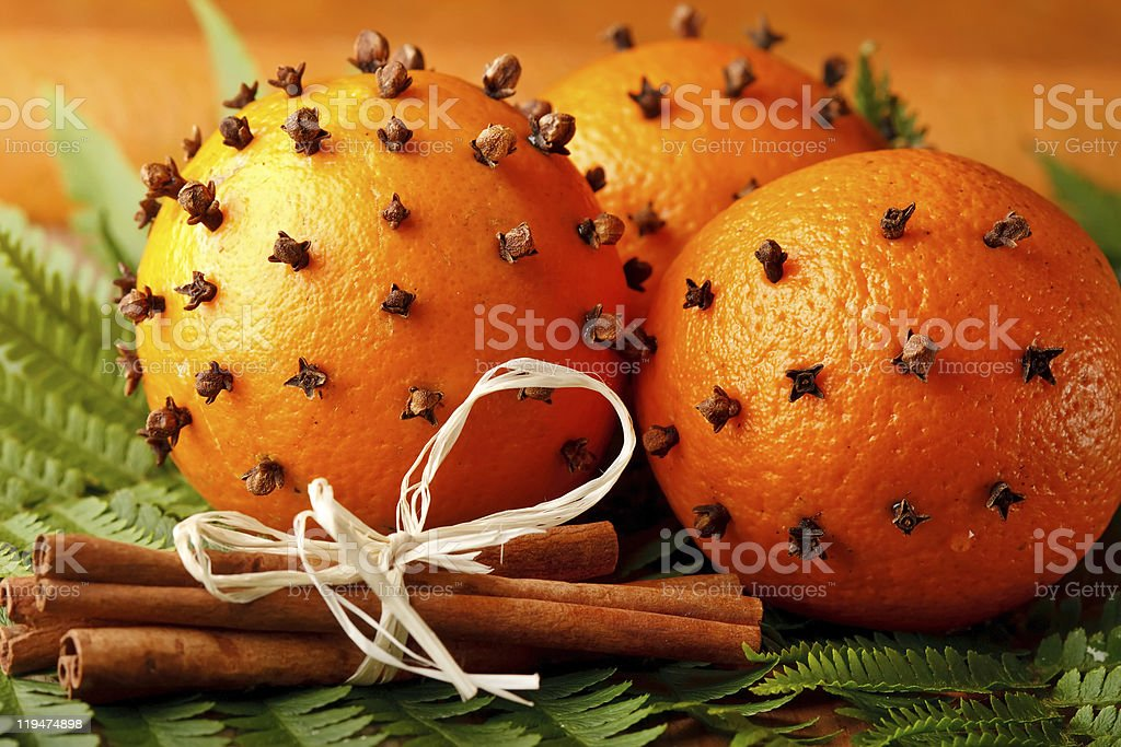 A set of Christmas oranges with a bunch of cinnamon stock photo