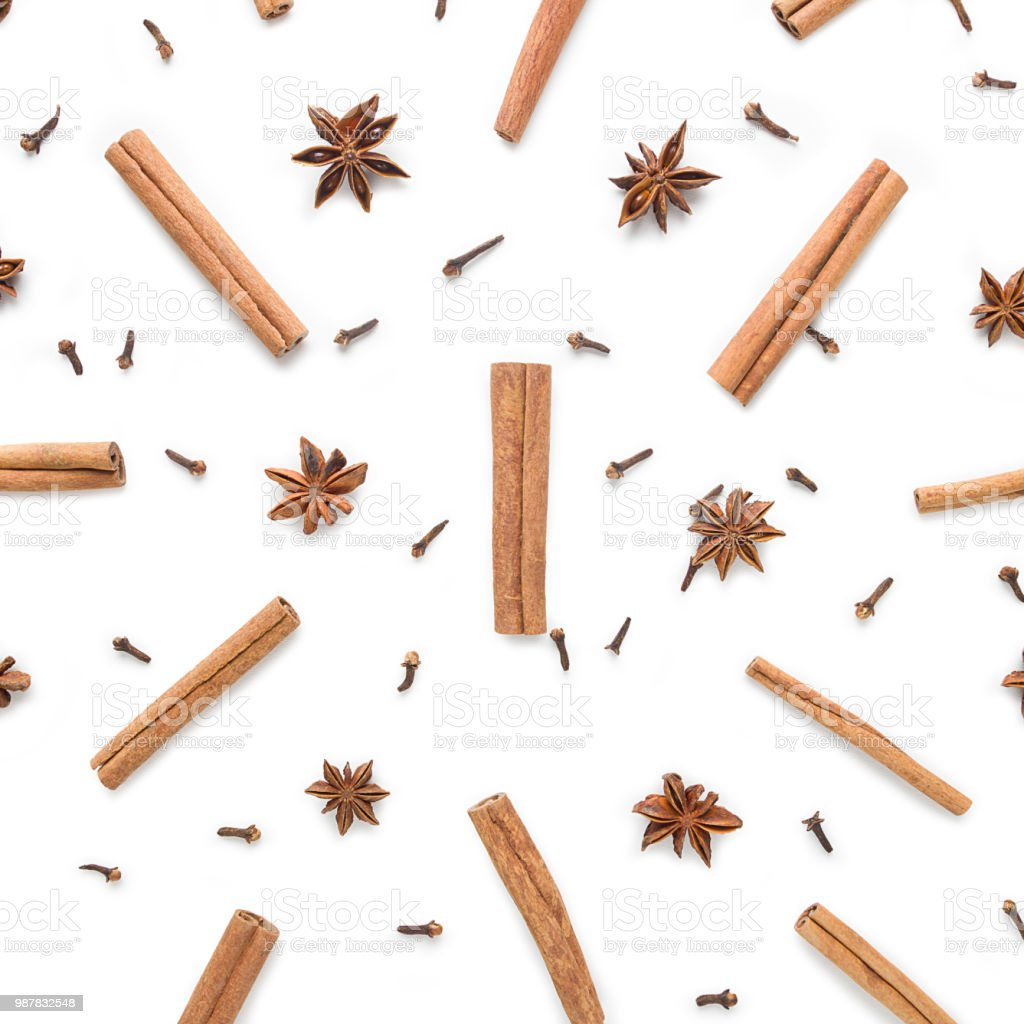 Set of cinnamon, clove and star anise, scattered in a chaotic manner, isolated on white background stock photo