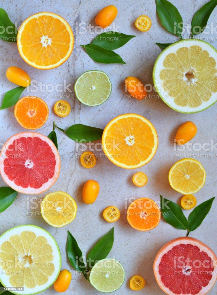 Set of citrus on light background: orange, mandarin, lemon, grapefruit, lime, kumquat, tangerine. Fresh organic juicy fruits. Source of vitamin C. Healthy food concept. Copy space stock photo